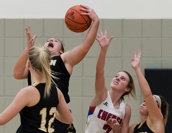 Haven's Maguire Estill (54) grabs the rebound over Cheney's Kylee Scheer (2) during their game at the Wildcat Classic Basketball Tournament at Haven Tuesday. Cheney defeated Haven 70-34.