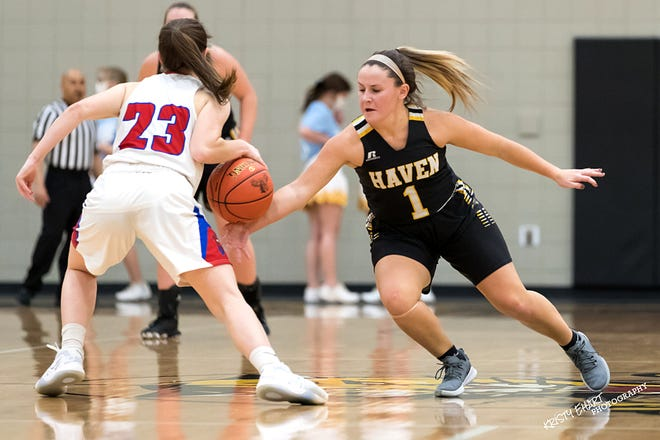 Haven's Carlee Arnold (1) knocks the ball out of the hands of Cheney's Brynn McCormick (23) during their game at the Wildcat Classic Basketball Tournament at Haven Tuesday. Cheney defeated Haven 70-34.