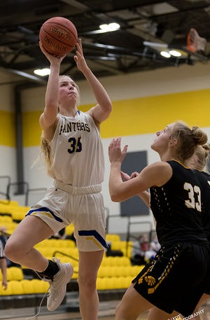 Nickerson's Ava Jones (35) shoots the ball over Andale's McKenzie Fairchild (33) during their game at the Wildcat Classic Basketball Tournament in Haven Tuesday night. Andale defeated Nickerson 39-34 in overtime.