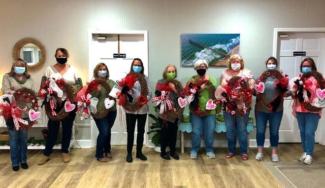 """Surf City Parks and Recreation recently hosted a Valentine's Day wreath workshop held at the Surf City Welcome Center. These """"Gal-entines"""" enjoyed sweet treats while making their holiday wreaths with the supplies provided. For more information on upcoming events visit SurfCityNC.gov."""