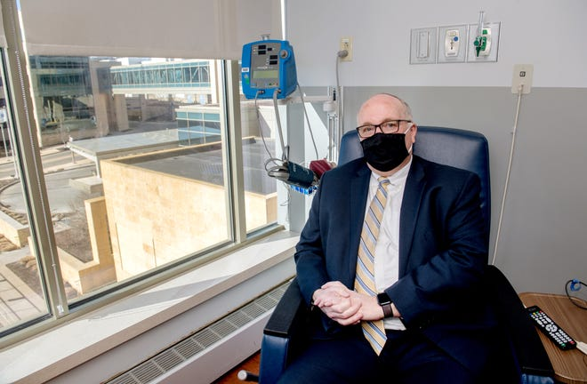 Jay Collier, Vice President of Clinic Operations at UnityPoint Health, sits in an infusion room at the hospital in Downtown Peoria. Collier, 61, contracted COVID-19 in December and received an infusion of monoclonal antibodies which he believes greatly improved his prognosis.