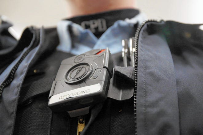 A criminal justice overhaul bill awaiting Gov. JB Pritzker's signature would require all police officers in Illinois to wear body cameras by 2025.
