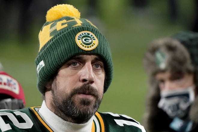 Green Bay Packers quarterback Aaron Rodgers walks off the field Sunday after the NFC championship game against the Tampa Bay Buccaneers in Green Bay, Wis. The Buccaneers defeated the Packers 31-26 to advance to the Super Bowl.
