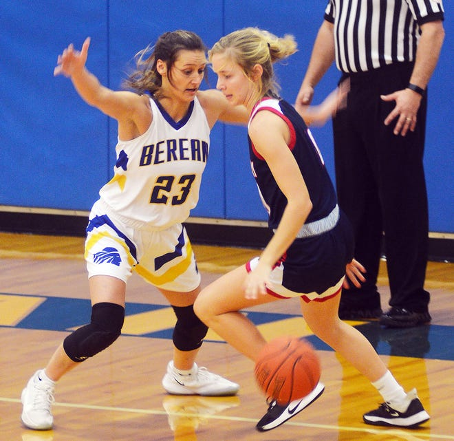Berean Academy senior Miranda Wiebe guards Minneapolis sophomore Alayna Cossart during play Tuesday in Elbing. The Warriors conclude tournament play Saturday.
