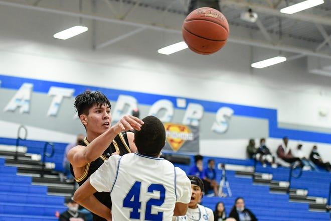 Snyder's Eber Murillo (50 passes the ball against Estacado during a District 3-4A contest Jan. 26 at Estacado High School.