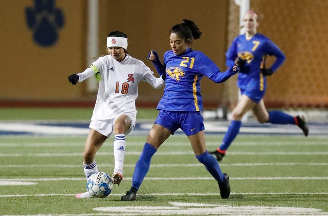 Frenship's Gaby Deleon (21) fights for the ball with San Angelo Central's Angel Alvarado (18) during the District 2-6A opener on Tuesday in Wolfforth. [Mark Rogers/For A-J Media]
