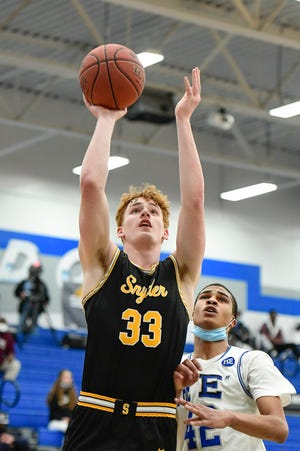 Snyder's Zach Miller (33) shoots the ball against Estacado during a District 3-4A game Jan. 26 at Estacado High School. Miller had 13 points to help the Tigers down Perryton in a Class 4A bidistrict game.