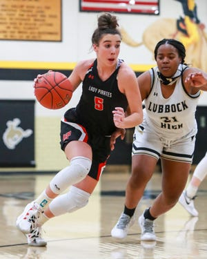 Lubbock Cooper's Avrie Douglas (5) handles the ball against Lubbock High on Tuesday, Jan. 26, 2021, at Westerner Arena in Lubbock, Texas.