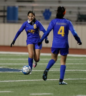 Frenship's Chloe Hinojosa (8) moves the ball downfield in the first half of a District 2-6A match Jan. 26 against San Angelo Central at Peoples Bank Stadium in Wolfforth. [Mark Rogers/For A-J Media]