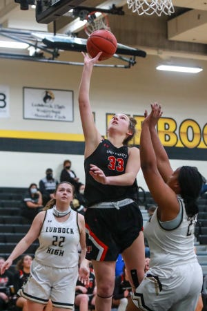 Lubbock Cooper's Bella Sipowicz (33) shoots the ball against Lubbock High during a District 4-5A game Jan. 26 at Westerner Arena in Lubbock.