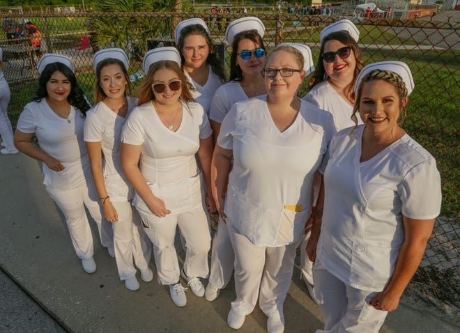 Nursing grads from Travis Technical Colleges before graduation at Lake Gibson High School in June. The Polk County school district is using COVID-relief funds to provide assistance to technical college students.