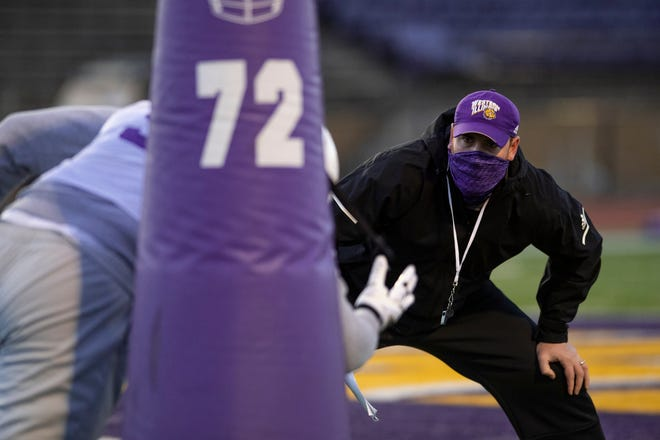 Western Illinois football coach Jared Elliott watches a drill during practice.,