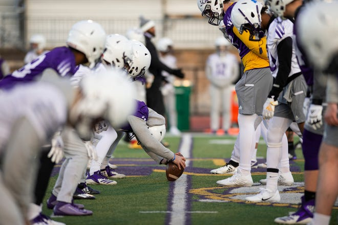 The Western Illinois offensive and defensive line before a snap.