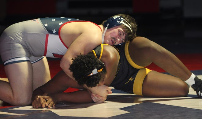 Moberly junior Beau Garrett leans on top of his 195-pound opponent, Fulton's Ja'Dontae Ray, during a home triangular meet held Tuesday. Garrett finished off Ray winning a 6-1 decision and the Spartans team secured a 39-34 dual victory as well.
