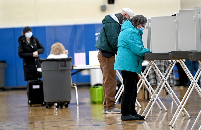 Ashland voters mark their ballots during a Special Town Election at the high school, Jan. 27, 2021. Voters overwhelmingly approved funding construction of a new public safety building and rebuilding the David Mindess Elementary School.