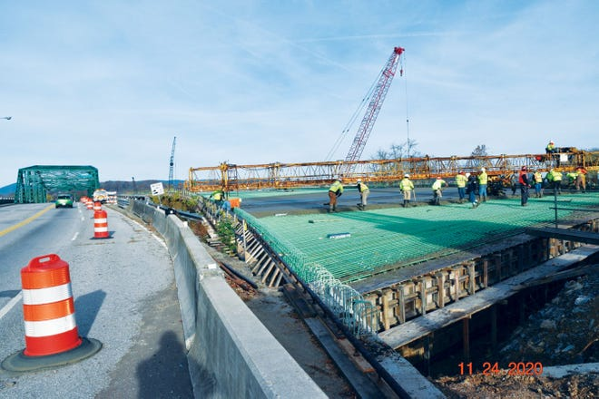 Workers continue their work on the Lewallen Bridge replacement project.