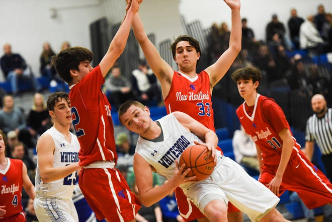 New Hartford and Whitesboro basketball teams play in January 2020. Basketball is considered a high-risk sport under state guidelines. Oneida County said local officials agree there are barriers that are difficult to overcome.