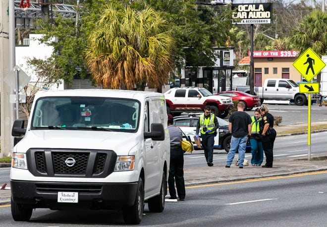 Ocala Police and employees with the Medical Examiner's Office work the scene Wednesday where a pedestrian was struck and killed by a vehicle in the 100 block of South Pine Avenue. The crash happened about 10:30 a.m. The driver of a Volkswagen Beetle was heading south on Pine when he struck the pedestrian in the crosswalk near Starbucks. The crash is under investigation.