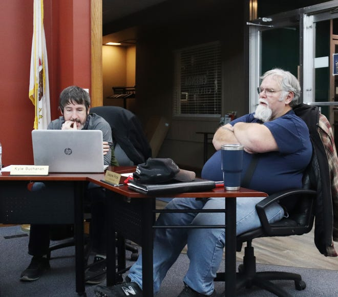 Chenoa City Commissioner Dwayne Price, right, speaks during Tuesday's city council meeting. Commissioner Kyle Buchanan looks over information while listening.