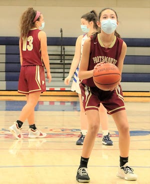 Portsmouth High School sophomore Bella Slover prepares to shoot a free throw during Tuesday's Division I girls basketball game at Winnacunnet.