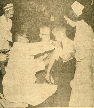 Paul LeVasseur receives his polio vaccine from Dr. Edwin Lee, health officer at Exeter High School's Talbot Gymnasium. Former Exeter Historical Society curator of collections, Nancy Merrill, is the nurse on the right.