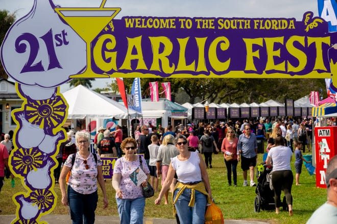 Visitors enjoy the food tents during the  South Florida Garlic Fest Saturday inside John Prince Park in Lake Worth Beach on February 8, 2020.  [RICHARD GRAULICH/The Palm Beach Post]