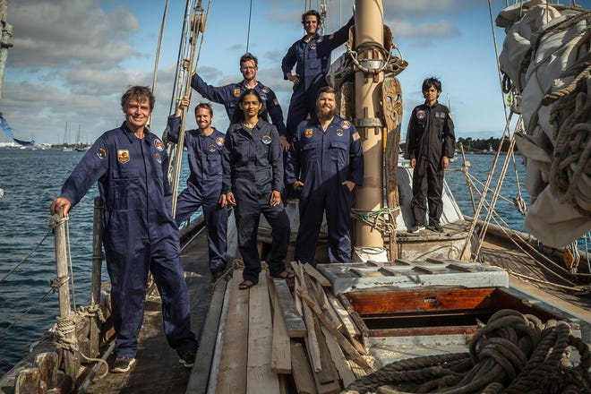 """Reid Stowe, left, and his crew aboard the schooner Anne in the Intracoastal Waterway near the Palm Beach Sailing Club on Tuesday, January 26, 2021. Left to right: Stowe, Eric Goss, Soanya Ahmad, John Wolfe, Andrew West, Oliver Parody and Darshen Stowe. Stowe is leading a voyage to psychologically prepare humanity for evolving off of planet Earth, he said. """"We are analog astronauts,"""" Stowe said. They plan to sail to Boca Chica, Tex., a launch site for SpaceX flights."""
