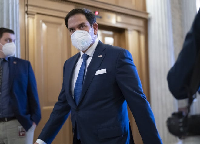 Sen. Marco Rubio (R-Fla) arrives at the Senate chamber on Tuesday to take an oath and vote on how to proceed on the impeachment against former President Donald Trump.