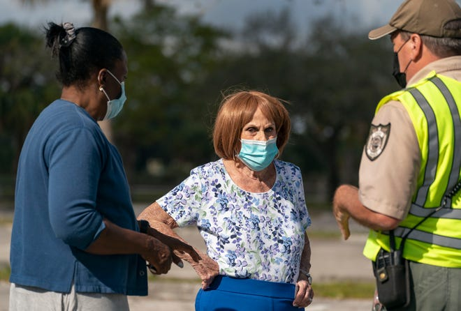 Frances Jasmine, left, with Fran Budnik, 91, who wanted to get vaccinated without an appointment at a health district COVID-19 appointment-only vaccination site that closed after running out the vaccine in John Prince Park in Lake Worth Beach on Wednesday.