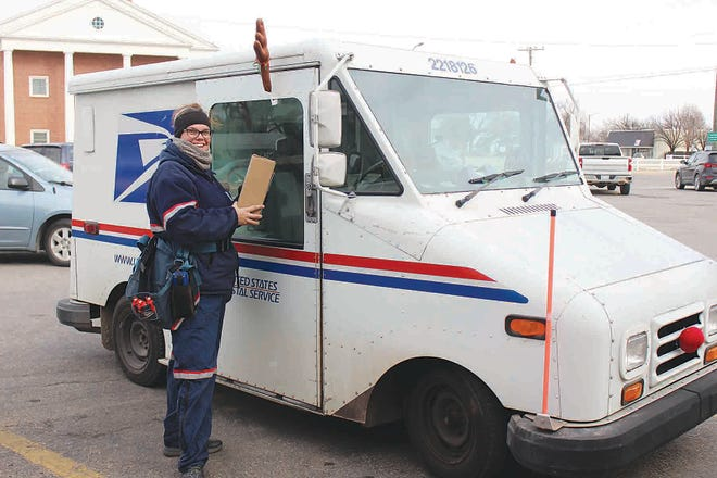 Britt Oller, Pratt postal service worker, delivered some good news to hundreds of Pratt residents last week, then found herself and her family on the receiving end of an unforgettable and kind gesture.