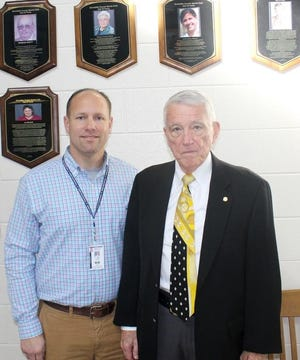 Bill Knott (right), seen in this November 2016 file photo, served as Dinwiddie's public address announcer for 51 years.