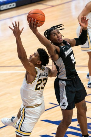 Providence's David Duke, right, reaches for the rebound over Villanova's Jermaine Samuels during a game on Jan. 23. The Providence native announced on Friday that he will forgo his senior season at PC in order to go pro.