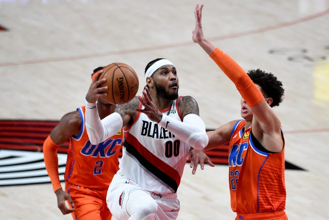 Portland's Carmelo Anthony (00) drives to the basket against Oklahoma City's Isiah Roby (22) during the second half of Monday's game in Portland. The Trail Blazers play Houston on Thursday night.