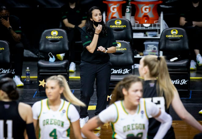 Oregon assistant basketball coach looks on from the sideline during the Ducks' Jan. 24 game against Washington at Matthew Knight Arena.