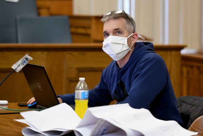Rick Arnold, a programmer with AVI-SPL, works to complete the installation of equipment and new technology at the Stark County Courthouse in Canton. The $158,000 system to allow for remote court hearings is among the ways the county has spent $19.3 million in emergency CARES Act assistance to combat the pandemic.