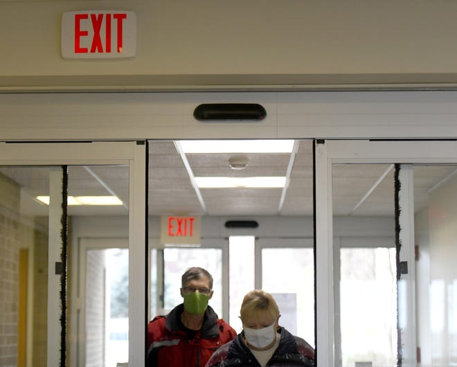 Steve and Jeanie Wilcox enter Rodman Public Library in Alliance on Wednesday through new electronic, no-touch doors that were intalled using CARES Act funds.