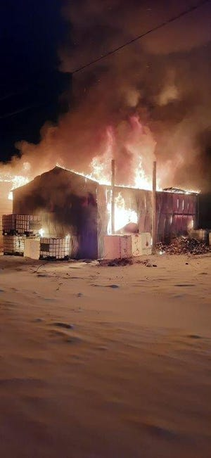 A fire destroyed a building north of Salina Tuesday night.
