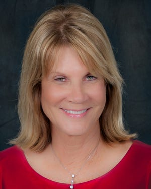 Manatee County Commissioner Carol Whitmore is swatting down accusations that she blackmailed a fellow commissioner.