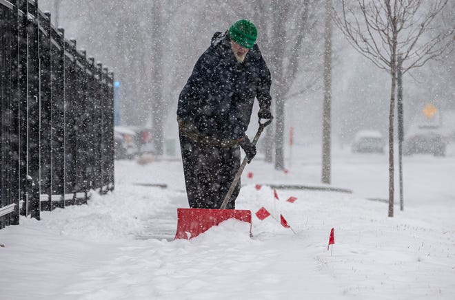 "William Yoswig clears the snow from the sidewalks around the Downtown YMCA in Springfield, Ill., Wednesday, January 27, 2021. The Springfield area had received around 2"" of snow as of 1:30 p.m. according to the National Weather Service in Lincoln. [Justin L. Fowler/The State Journal-Register]"