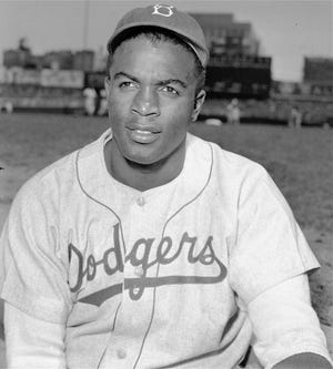 This is an April 18, 1948 portrait of Brooklyn Dodgers' infielder Jackie Robinson. Robinson was born on Jan. 31, 1919, in Cairo, Georgia.