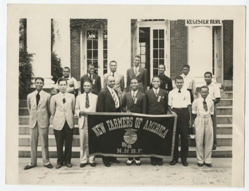 An unidentified New Farmers of America student members holding a NFA banner.