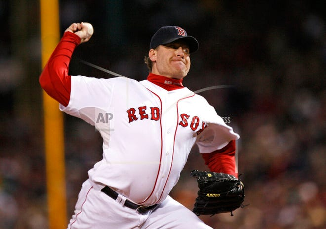 In this Oct. 25, 2007, file photo, Boston Red Sox's Curt Schilling pitches against the Colorado Rockies in Game 2 of the baseball World Series at Fenway Park in Boston.