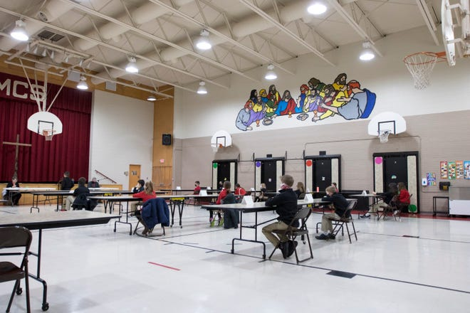 Students take part in a spelling bee in Manhattan Catholic Schools. Private schools have been at the center of a debate over expanding school choice programs, something critics believe will hinder public education in Kansas.