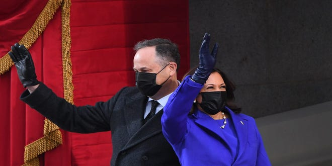 Vice President Kamala Harris is seen here on inauguration day on Jan. 20. She is the first woman, the first Black person, and the first person of South Asian descent to serve as VP. Her husband Doug Emhoff, left, is the nation's first Second Gentleman.