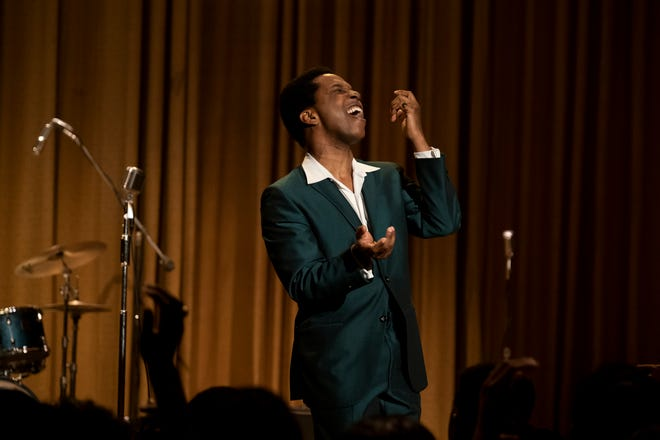 """""""One Night in Miami ..."""" ends with a performance by Sam Cooke, portrayed by Leslie Odom Jr. )"""