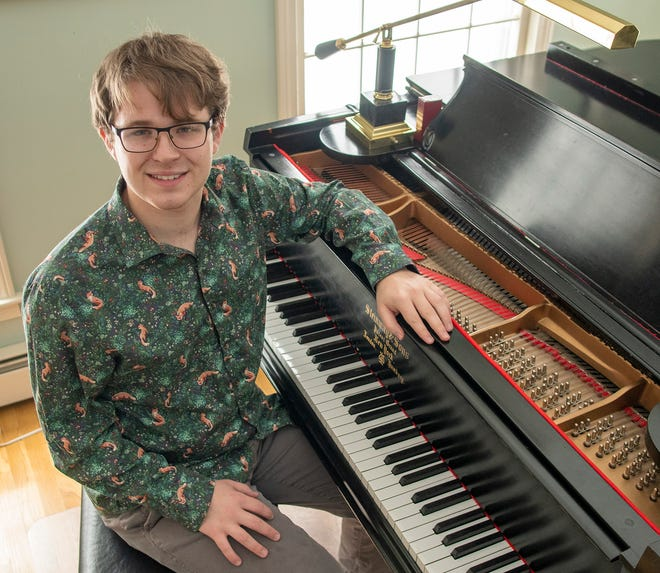 BOYLSTON - Jazz pianist and composer Andrew Wilcox sits at the piano in his Boylston home Wednesday, January 27, 2021.