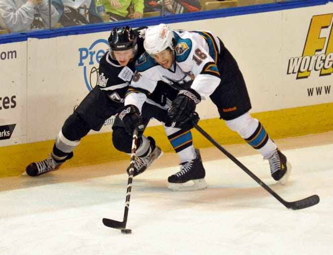 The Worcester Sharks' Bracken Kearns, right, works to keep the puck away from the Manchester Monarchs' Robert Czarnik during a game in November 2013.