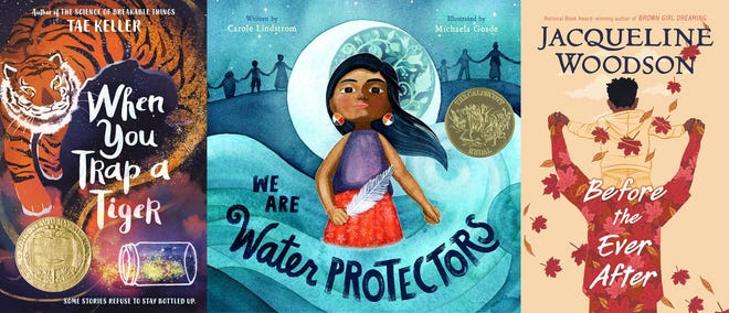 """From left, """"When You Trap a Tiger,"""" winner of the John Newbery Medal for the outstanding children's book overall of 2020, """"We Are Water Protectors,"""" written by Carol Lindstrom and illustrated by Michaela Goade, winner of the Randolph Caldecott Medal for best children's picture story, and """"Before the Ever After"""" by Jacqueline Woodson, who won her third Coretta Scott King Award for best work by a Black author."""