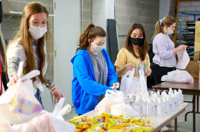 Student volunteers from the Southside High School Key Club assemble Personal Protective Equipment packages at Gadsden's City Hall on Monday, Jan. 25, 2021.