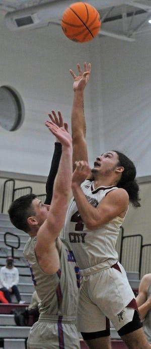 Gadsden City's DeMarcus Macon gets a floater up over a Vestavia Hills defender during a high school basketball game Tuesday, Jan. 26, 2021, at Gadsden City High School.